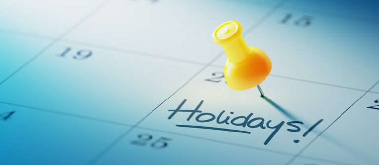 Concept image of a Calendar with a yellow push pin shutterstock_271995236