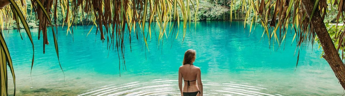 A-young-woman-in-blue-lagoon-in-Jamaica-shutterstock_1071284249