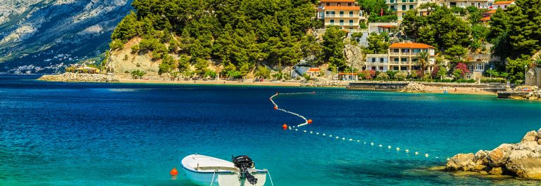 Beautiful coastline and beach with motorboat,Brela,Dalmatia regi