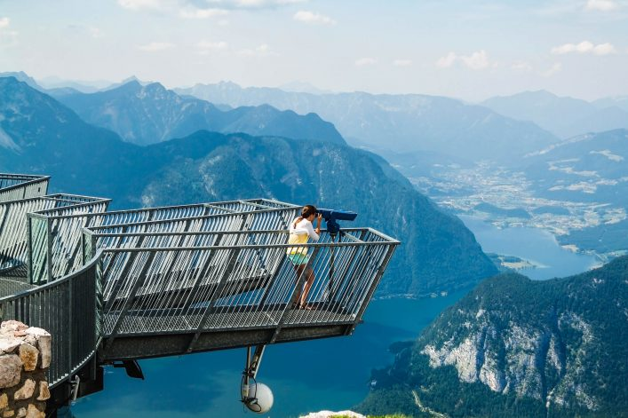 Young girl standing on the viewing platform Five Fingers.  Alps