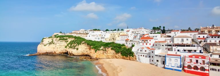 Portuguese villa in Carvoeiro beach with clear blue sea.