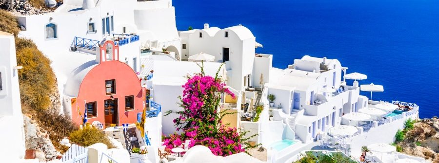 Santorini-Greece.-Famous-attraction-of-Oia-village-at-sunset-with-windmill-in-Greek-Islands-Aegean-Sea.-shutterstock_716874097