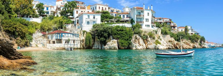 Skiathos-old-port-with-a-blue-sky-shutterstock_693252220