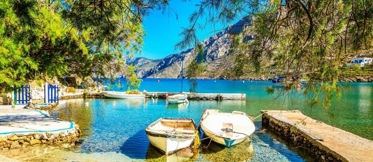 Peaceful haven with boats in sea bay of Greek island, Greece
